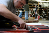 Enver Kasum, cq, of Robert Mann Oriental Rugs, 2540 Walnut St finishes restoring an 1890 Navajo...