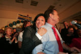10:10PM -  7th congressional district winner Ed Perlmutter (D) is hugged by his wife Deana as he...