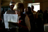 (DLM0335) -  Natalie Roesch checks over her ballot sheet that helps her organize how she is going...