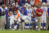(MAP905)The Denver Broncos Mike Bell (#20, RB) slips the tackle of the Indianapolis Colts Marlin...