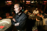 Nick Myers, President and COO of the National Pub Poker League, LLC, oversees a league poker night...