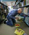 Carl Herbet puts away library books at Eisenhower Elementary School in Boulder on October 24,...