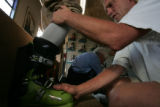 Larry Houchen (cq)  fits Greg Friedman with a new shell at his Boulder shop Monday October 30,...