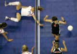Cherry Creek's Carrie Baird, left, misses the point as Durango's Colleen Keresey celebrates...