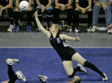 Longmont Trojans' Bri Taylor dives for the ball in Class 4A action against the Battle Mountain...