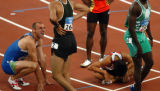 (Athens, Greece  on Friday, Aug. 20, 2004) - Matija Sestak, of Slovakia, far left, tries to catch...
