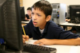 Sixth grader at West Denver Preparatory Charter School, Jovany Hidrogo, 11, works on a computer...