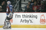 Colorado Avalanche goalie Peter Budaj skates by an Arby's as that is a advertisement  campaign...