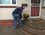 Chris Cardiff (cq), who lives up the street from the Bingham family, brings flowers to the family...