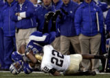 Air Force's Vic Thompson, left, is up ended by  Notre Dame Fighting Irish defender Ambrose...