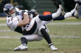 (BG0679} Denver Broncos Stephen Alexander is tackled by an Oakland Raider in the second quarter at...