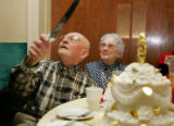 Bill Campbell (cq), of Denver, gets ready to cut a cake with his wife, Hazel at the 59th Annual...
