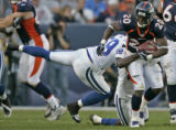 (BG773) Denver Broncos is tackled by Indianapolis Colts Marlin Jackson in the third quarter at...