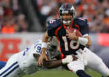 (JPM177) Denver Broncos Jake Plummer, #16, scrambles away from Indianapolis Colts Anthony...