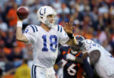 (MAP727)The Indianapolis Colts Peyton Manning (#18, QB) looks to pass downfield as the Denver...