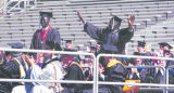 (LT. TO RT.) Lost Boys of Sudan and the first to graduate from the University of Colorado Kur...