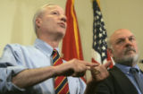 Republican Secretary of State-elect Mike Coffman, left, and Ken Gordon make a joint statement...