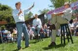 (8/06/2004, GOLDEN, CO)    John Edwards addresses a question while Jim Nelson and John Kerry watch...