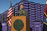 DLM00029   Denver Mayor John Hickenlooper stands in front of a mountainous stack of the city's new...