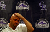 (DENVER, Colo., Aug 6, 2004)  Larry Walker, former Colorado Rockies baseball player, holds back...
