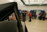 (BG939) Loretta Nunez, (w/tilde over 'n') CQ, 63, from Denver, votes in the early voting center at...