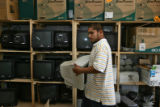 Jonathan Esquivel (cq) carries a monitor to a storage shelf Monday morning, October 29, 2006, in...
