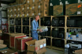 Robert Kinsley (cq) stores keyboards in a storage area on Monday morning, October 29, 2006 in the...