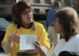L to R: Aica Haywood (cq) hands out information to voter Dianna Alire (cq)  outside the Webb...