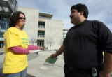 Jenny Flanagan (cq) talks to voter Larry Botnick (cq) outside the Webb Building in Denver on...