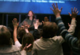 The faithful express their reverence with hands in the air at the New Life Church in Colorado...