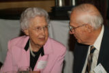 Christian Living Communities residents Doris Wynkoop and Fred Moulton enjoy a conversation during...