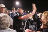 Limon High School Badger Iasaac Ashcraft, left, high fives Brenda Liggett (cq) after Limon beat...