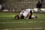 (DLM3538) -  Fairview High School junior offensive lineman Kyle LaMar gets a little shaken up on a...