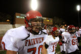 (DLM3619) -  Fairview High School junior offensive lineman Jake Schalamon cheers on the defense...