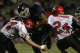 (DLM3701) -  Overland High School senior running back Justin Cooper bangs his way through the...