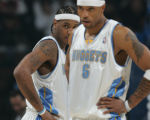 (JPM0209)  Denver Nuggets Carmelo Anthony and Kenyon Martin stare at a refereeafter teammate J.R....