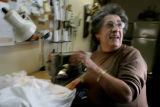 Adriana Tsilepis, CQ, 63, keeps a sense of humor while working at her Singer sewing machine at...