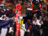 [RMN120] - In the first quarter, Denver Broncos Domonique Foxworth, (22) watches as Broncos Champ...