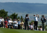 (Castle Rock, Colo., August 8, 2004) Tom Pernics Jr. hits an iron shot on the 18th hole during the...