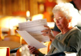 (CREDIT: Joshua Buck / Longmont Daily Times-Call) Naydene Schunder  looks over a list of voters in...