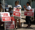 (DENVER, CO. 8/08/04) Jenifer Knight ( left ) and Perla Gheiler puts signs up  for the The Latina...
