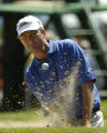 (Castle Rock, Colo., August 8, 2004) Last year's winner Davis Love III hit out of a bunker on the...
