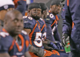 [ES081] - Denver linebacker Al Wilson watches as the Broncos comeback hopes fade at the end of the...