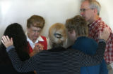 MJM104 Nancy Seagrove (cq), left, prays with her fellow members of the Behind the Scenes Prayer...