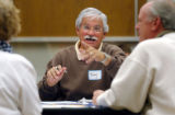 (CREDIT: Joshua Buck / Longmont Daily Times-Call) Rudy DeSousa  talks with fellow members of his...