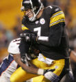 (JPM1390) In the fourth quarter, Denver Broncos Demetrin Veal hits Pittsburgh Steelers quarterback...