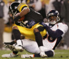 (JPM901) In the third quarter, Denver Broncos Curome Cox, #40, pulls down Pittsburgh Steelers Nate...