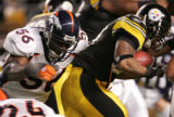 (JPM953) In the third quarter, Denver Broncos Al Wilson, #56, can't stop Pittsburgh Steelers...