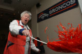 Catholic nun Marie Paula Hardy (cq) leads a Broncos cheer Sunday afternoon November 5, 2006 at...