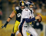 The Denver Broncos Jake PLummer (#16, QB) takes off on the run while being chased by the...